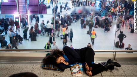 Stranded passengers sleeping on the floor.