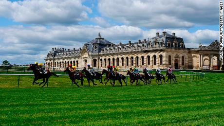 Chantilly racecourse features views of a chateau and the famous Great Stables (pictured).