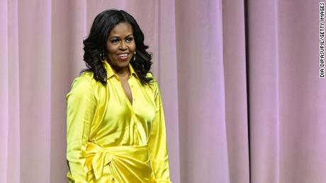 "NEW YORK, NEW YORK - DECEMBER 19:  Former first lady Michelle Obama discusses her book ""Becoming"" at Barclays Center on December 19, 2018 in New York City. (Photo by Dia Dipasupil/Getty Images)"