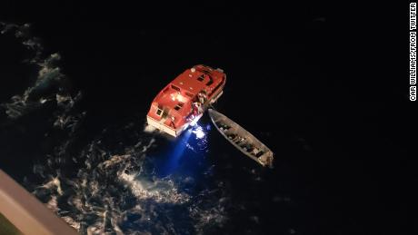 Two mariners were stranded aboard this gray vessel for 20 days, a Royal Caribbean spokesman said.