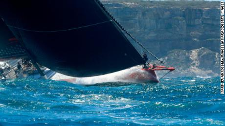 Reigning champion Comanche sails out of the Sydney Heads at the start of the 2018 Sydney Hobart yacht race.