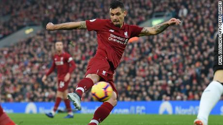 Liverpool's Croatian defender Dejan Lovren shoots to score the opening goal of the English Premier League match against  Newcastle United at Anfield.