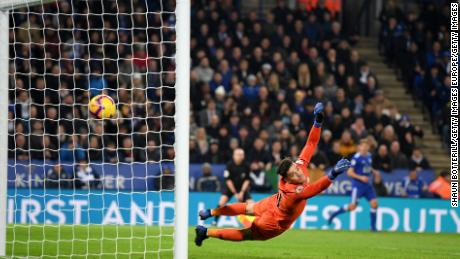 Manchester City goalkeeper Ederson can only watch as Ricardo Pereira's shot flies past him for Leicester City's winner