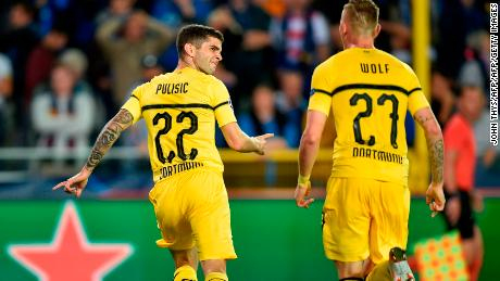 Pulisic celebrates scoring against Club Brugge in the Champions League