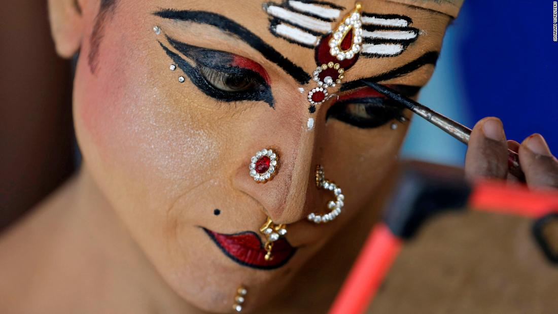 A man applies makeup Tuesday, January 1, before performing at the Cochin Carnival, which is held annually in India's Kerala state to welcome the start of the new year.