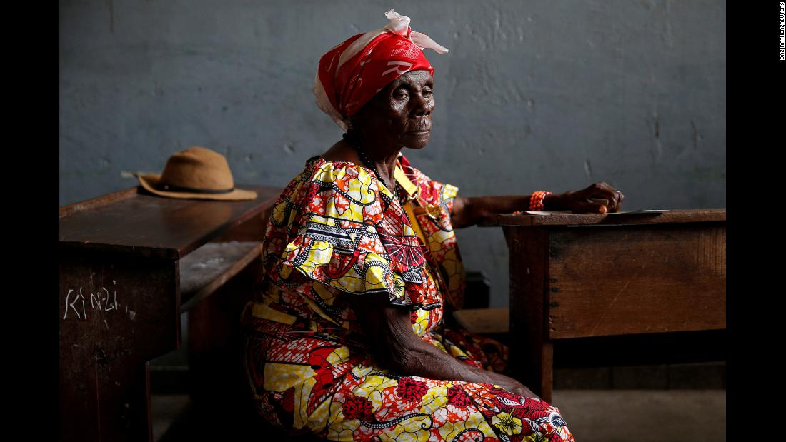 """A woman waits to cast her vote at a polling station in Kinshasa, Congo, on Sunday, December 30. <a href=""""https://www.cnn.com/2018/12/30/africa/congo-delayed-election/index.html"""" target=""""_blank"""">Voters were picking a successor to President Joseph Kabila,</a> who has ruled the central African country since 2001. The results were expected to be announced in mid-January."""