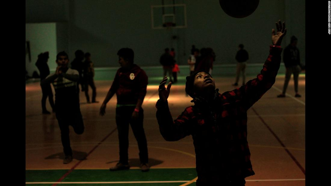 Migrant children from Central America play at a gym that was being used as an emergency shelter in Ciudad Juarez, Mexico, on Saturday, December 29.