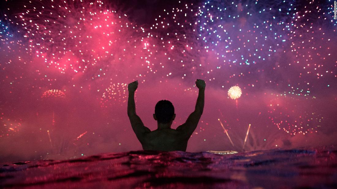 "A man watches <a href=""http://www.cnn.com/2018/12/31/world/gallery/2019-new-year-around-the-world-12312018/index.html"" target=""_blank"">New Year's fireworks</a> explode over Copacabana Beach in Rio de Janeiro. <a href=""http://www.cnn.com/2018/12/27/world/gallery/week-in-photos-1228/index.html"" target=""_blank"">See last week in 28 photos</a>"