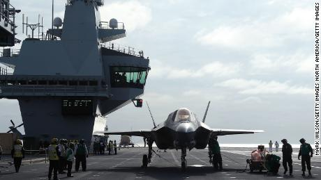 A new F-35B Lightning fighter jet is prepped for take off from the deck of the United Kingdom's new aircraft carrier, HMS Queen Elizabeth at sea in September 2018.
