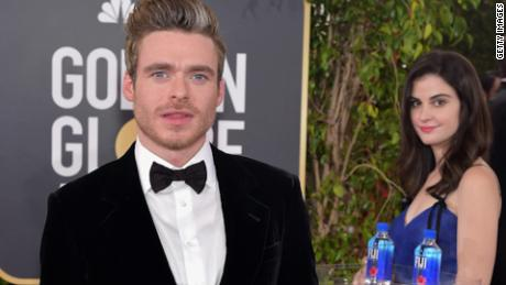 The Fiji Water girl strikes a pose behind Game of Thrones star Richard Madden