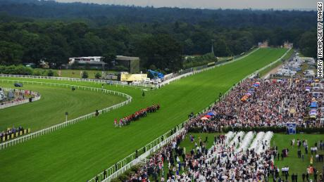 Queen Elizabeth II makes her way to the course ahead of racing at Royal Ascot.