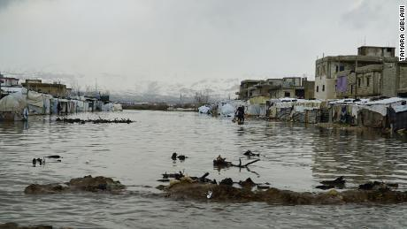 Plains, now submerged in water, separate two Syrian refugee camps in the Bar Elias area.