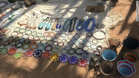 Women manufacture bright colored jewelry to sell to tourists who come to visit the village.