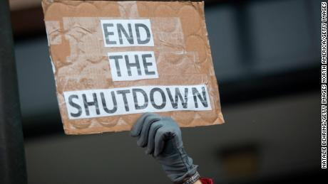 OGDEN, UT - JANUARY 10: A demonstrator holds a sign protesting the government shutdown at the James V. Hansen Federal Building on January 10, 2019 in Ogden, Utah. As the shutdown nears the three week mark, many federal employees will not receive a paycheck tomorrow.