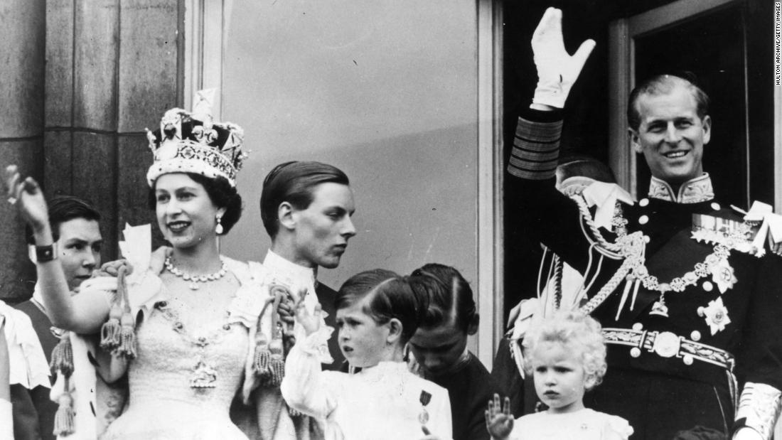 Prince Philip waves from the balcony of Buckingham Palace after his wife's coronation in June 1953.