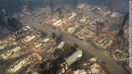 A wary and traumatized Paradise watches the raging inferno from nearby California fires