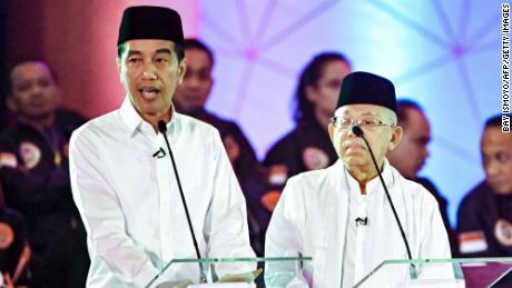 Presidential candidate and incumbent President Joko Widodo, pictured left, and his running mate, Maruf Amin, during a live nationwide TV debate in Jakarta on January 17.