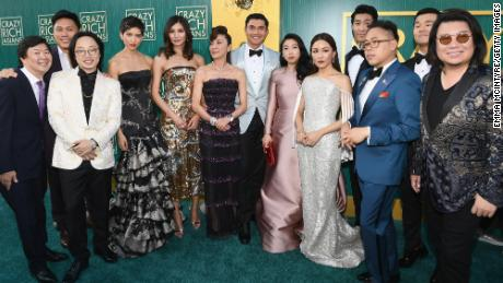 """Kwan, right, poses for a picture with the cast and crew of """"Crazy Rich Asians"""" at the film's August premiere at Los Angeles' Chinese Theatre."""