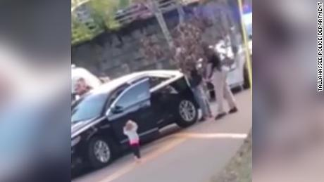 Caught on camera: Toddler walks over to police with hands up