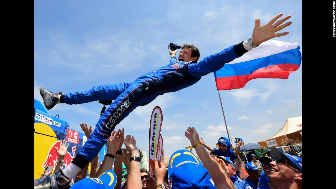 Russian co-driver Evgenii Iakovle is congratulated by team members after winning the Dakar Rally in Peru, on Thursday, January 17.