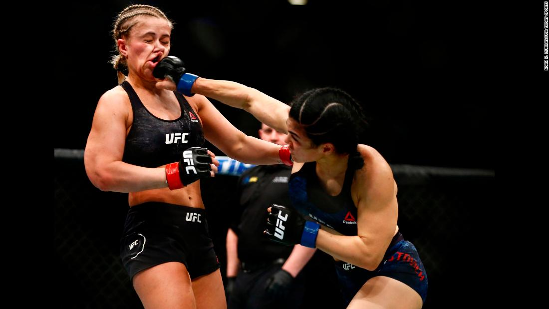 Rachael Ostovich lands a punch to the jaw of Paige VanZant during UFC Fight Night at Barclays Center in Brooklyn, New York, on Saturday, January 19.