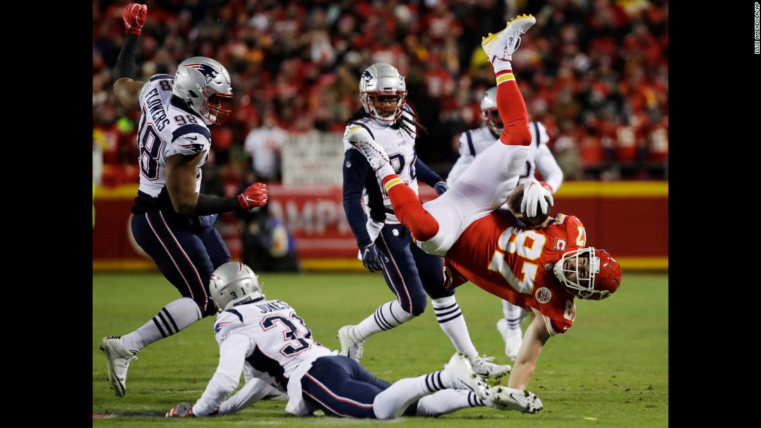 Kansas City Chiefs tight end Travis Kelce flips as he is tackled by New England Patriots defensive back Jonathan Jones during the first half of the AFC Championship game on Sunday, January 20.