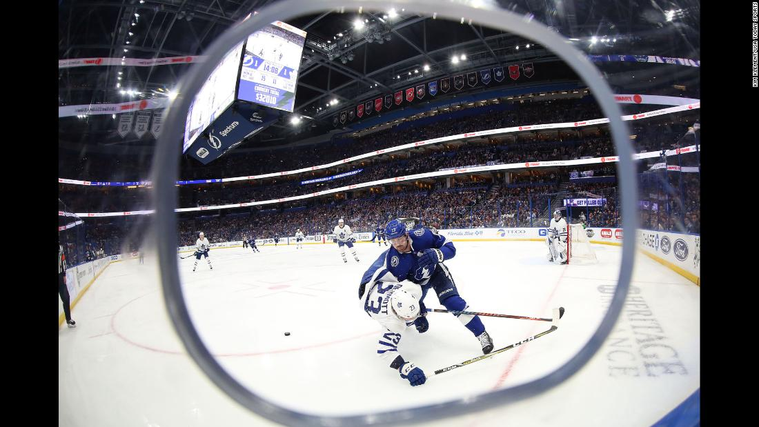 Tampa Bay Lightning left wing Alex Killorn, right, checks Toronto Maple Leafs defenseman Travis Dermott during the second period at Amalie Arena in Florida on Thursday, January 17.