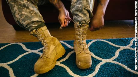 WAHIAWA, HAWAII - MARCH 26:  Army Sergeant Shane Ortega laces up boots before posing for a portrait at home at Wheeler Army Airfield on March 26, 2015 in Wahiawa, Hawaii.  (Photo by Kent Nishimura/For The Washington Post via Getty Images)