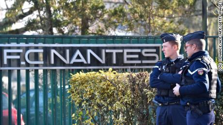French police gather Tuesday at the entrance of the FC Nantes training center in La Chapelle-sur-Erdre.