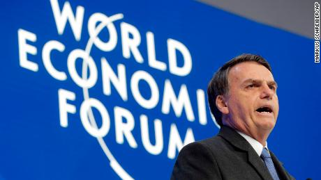 Brazil's hardline leader makes conciliatory Davos speech on environment