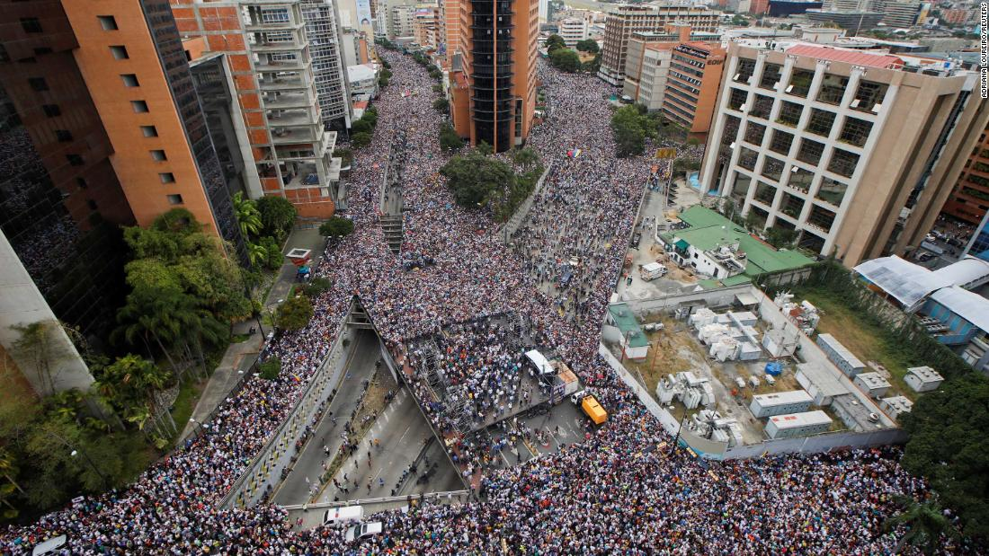 Opposition supporters in Caracas protest Maduro on January 23.
