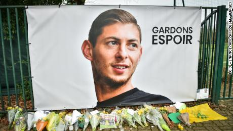 Flowers placed under a portrait of  Sala in Nantes.