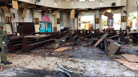 A soldier views the site inside a Roman Catholic cathedral in  southern Philippines after two bombs exploded Sunday.