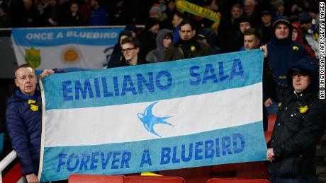 Cardiff fans hold up an Argentina flag at the Emirates Stadium on Tuesday.