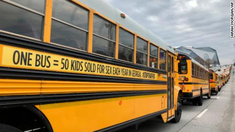 A number of school buses with new human trafficking prints set off on their way to Atlanta on January 2.