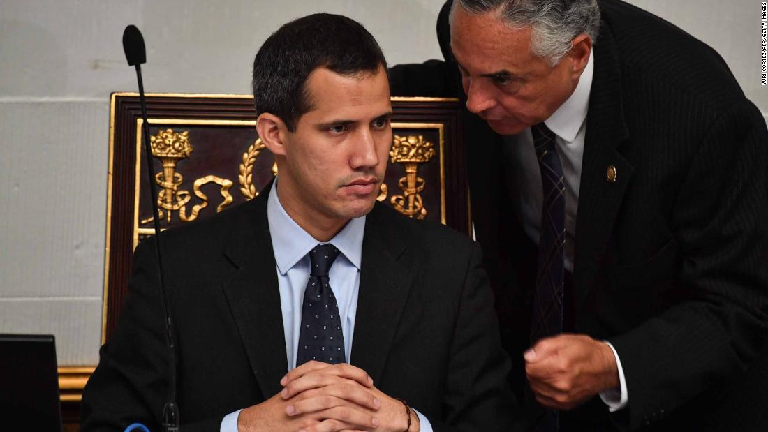 Guaido listens to deputy Rafael Veloz during a session at the National Assembly in Caracas on January 29. The Assembly met to debate a legal framework for creating a transitional government and calling new elections. Simultaneously, Venezuela's attorney general asked the Supreme Court to freeze Guaido's assets and bar him from leaving the country.