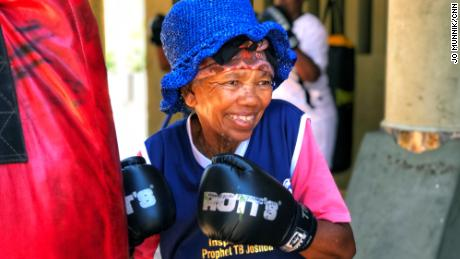 Gladys Ngwenya, 78, smiles during a boxing session at a gym in Cosmo City, South Africa.
