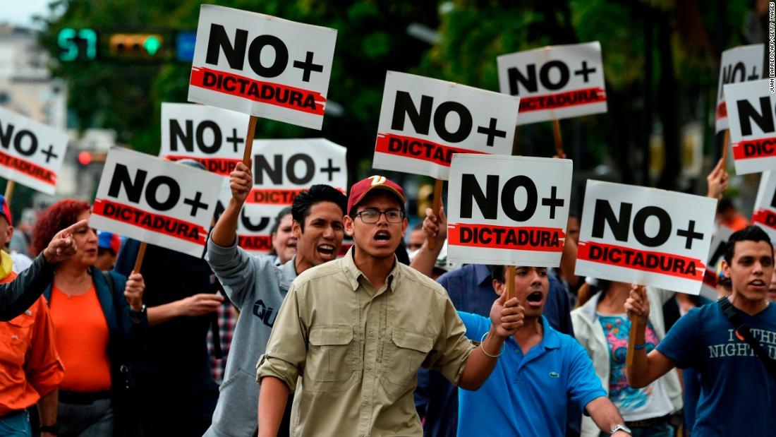 Opposition demonstrators protest against Maduro's government on Wednesday, January 30.