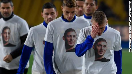 Nantes' first team wear t-shirts picturing Sala as they warm up for a match.