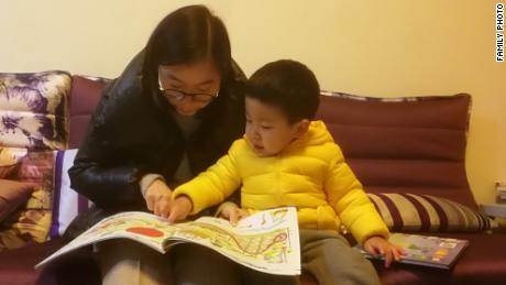 Chen Huijuan with her son Xiyan whose education and healthcare take up about a third of the household's salary.