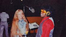 Jacque Hollander and James Brown in a recording studio.