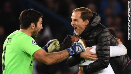Gianluigi Buffon, Paris Saint-Germain's Brazilian defender Thiago Silva and coach Thomas Tuchel celebrate beating Liverpool.
