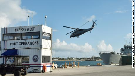 "181015-N-KM072-029 KEY WEST, Florida (Oct. 15, 2018) Helicopter Sea Combat Squadron HSC-28 ""Dragon Whales"" from Norfolk, Virginia, conduct exercises with special operators aboard Canadian coastal defense vessel HMCS Moncton in Naval Air Station Key West's Truman Harbor. HSC-28 is undergoing an evaluation by Helicopter Sea Combat Weapons School Atlantic during Helicopter Advanced Readiness Program (HARP) training. NAS Key West is a state-of-the-art facility for air-to-air combat fighter aircraft of all military services and provides world-class pierside support to U.S. and foreign naval vessels. (U.S. Navy photo by Danette Baso Silvers/Released)"
