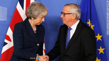 President of the European Commission Jean-Claude Juncker greets UK Prime Minister Theresa May in Brussels on Thursday.