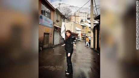 ShaparakShajarizadeh stands unveiled in an Iranian town waving a white scarf on a stick, as part of the anti-compulsory hijab protests of 2018.