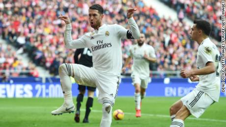 Sergio Ramos of Real Madrid celebrates after scoring in the Madrid derby.