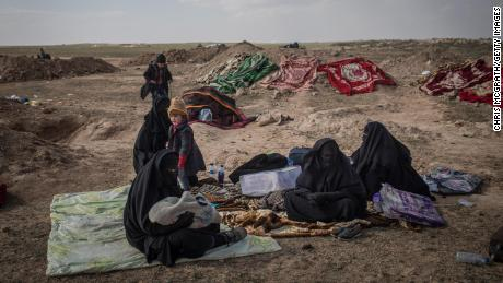 In the desert outside Baghouz Al-Fawqani, civilians are screened by the SDF.