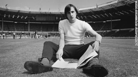 Johan Cruyff sits on the Wembley pitch before Ajax's 1971 European Cup final against Panathinaikos - the first of three consecutive titles for the Dutch club.