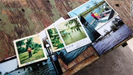 Chris Brunet's family photos show scenes of past life on Isle de Jean Charles, including when homes were flooded.