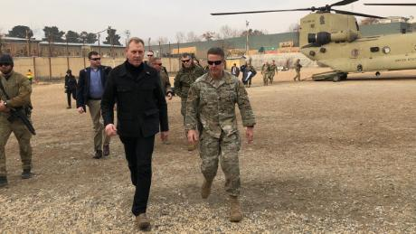 Patrick Shanahan (L) is greeted in Afghanistan by Gen. Austin Scott Miller.